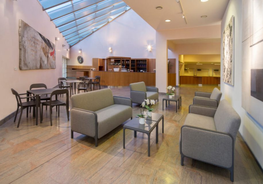 Cameo sofas and Earl chairs furnish the bar of the theatre