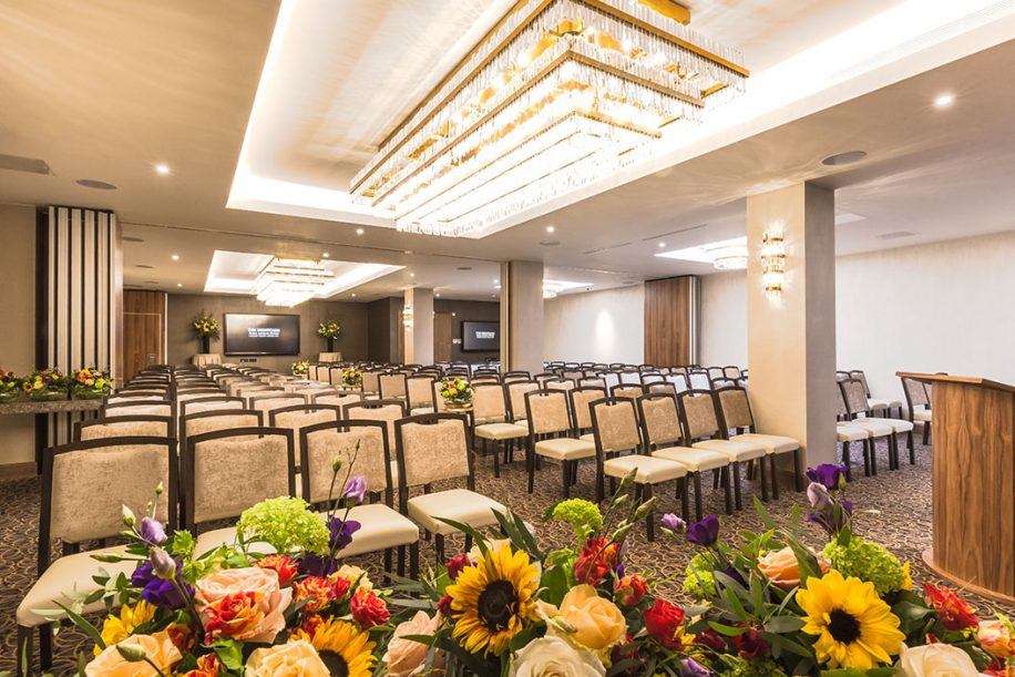 Flowers and Fandango chairs decorate and furnish the big conference room of Montcalm Royal London House Hotel